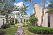 Walkway to pool - Condo for sale at 718 Golden Beach Blvd #3, Venice, FL 34285 - MLS Number is N6107011