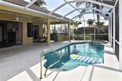 Pool to outdoor kitchen - Single Family Home for sale at 321 Dulmer Dr, Nokomis, FL 34275 - MLS Number is N6108685