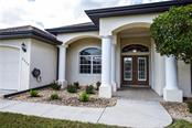 Front entry. - Single Family Home for sale at 2560 Pebble Creek Pl, Port Charlotte, FL 33948 - MLS Number is N6109100