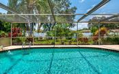 Pool with park like setting - Single Family Home for sale at 404 Gulf Breeze Blvd, Venice, FL 34293 - MLS Number is N6110481