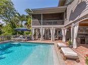Pool and upstairs porch - Single Family Home for sale at 2208 Casey Key Rd, Nokomis, FL 34275 - MLS Number is N6110959