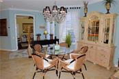 Dining room to bedroom 3/den - Villa for sale at 20117 Tesoro Dr, Venice, FL 34293 - MLS Number is N6111641