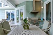 Outdoor kitchen - Single Family Home for sale at 725 Eagle Point Dr, Venice, FL 34285 - MLS Number is N6111842