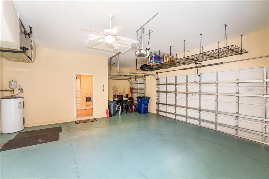 Large garage has room for two cars and a golf cart. - Single Family Home for sale at 931 Linkside Way, Punta Gorda, FL 33955 - MLS Number is C7400849
