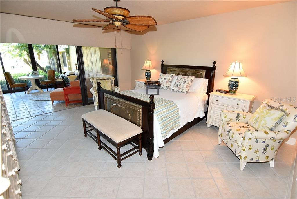 Master bedroom overlooks the Lanai - Condo for sale at 3210 Southshore Dr #11a, Punta Gorda, FL 33955 - MLS Number is C7402449