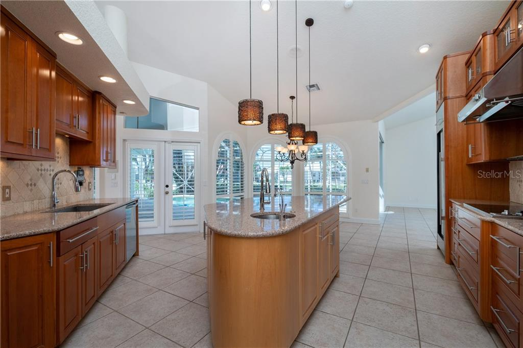 Stunning kitchen with great accent lighting. Just beyond is the large breakfast nook and family room. - Single Family Home for sale at 1309 Casey Key Dr, Punta Gorda, FL 33950 - MLS Number is C7413790