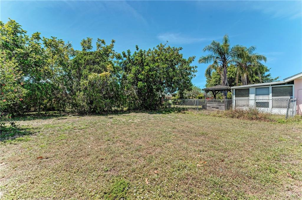 Single Family Home for sale at 13533 Dibella Ave, Port Charlotte, FL 33981 - MLS Number is C7414933