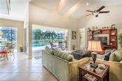 The great room extends seamlessly to the lanai and huge pool deck beyond. - Single Family Home for sale at 931 Linkside Way, Punta Gorda, FL 33955 - MLS Number is C7400849