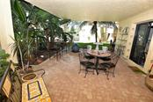 This is another view of the Tropical setting of this unique Patio off the second Guest Bedroom - Condo for sale at 3210 Southshore Dr #11a, Punta Gorda, FL 33955 - MLS Number is C7402449