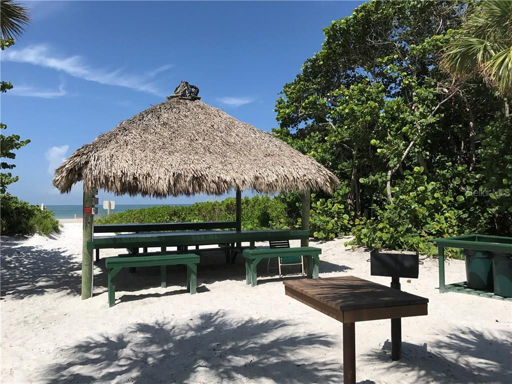 Tiki hut with barbeque - Condo for sale at 20 Whispering Sands Dr #301, Sarasota, FL 34242 - MLS Number is A4190302