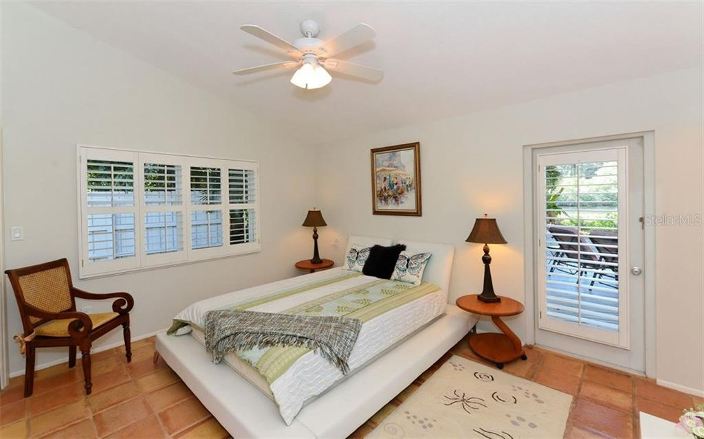 Single Family Home for sale at 7676 Midnight Pass Rd, Sarasota, FL 34242 - MLS Number is A4202655