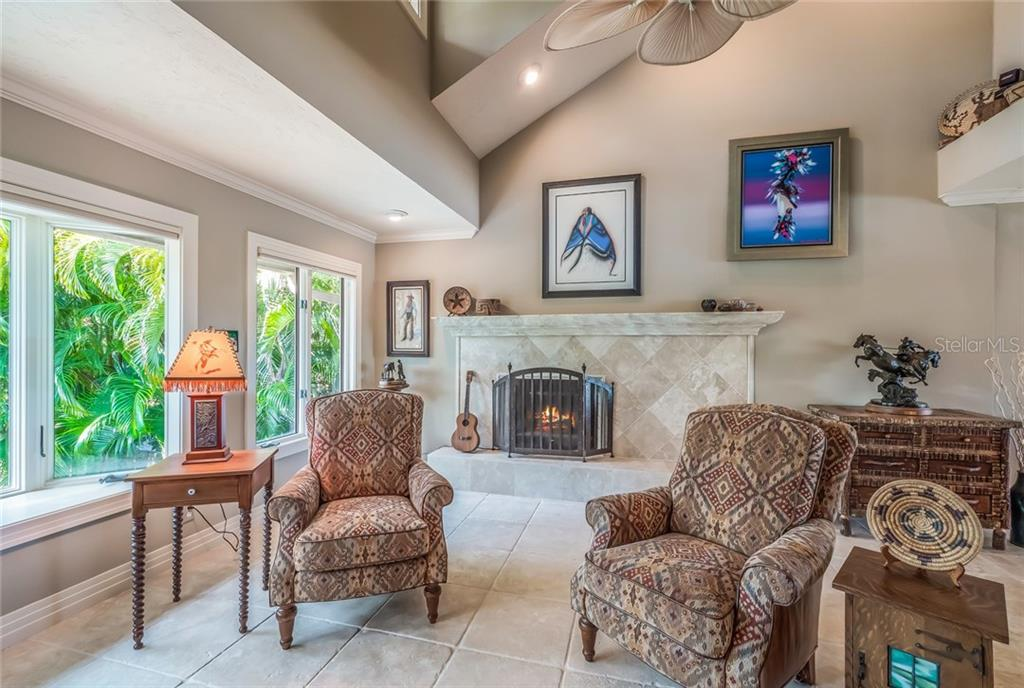 Relax by the wood or gas burning fireplace - Single Family Home for sale at 1253 Riegels Landing Dr, Sarasota, FL 34242 - MLS Number is A4203768
