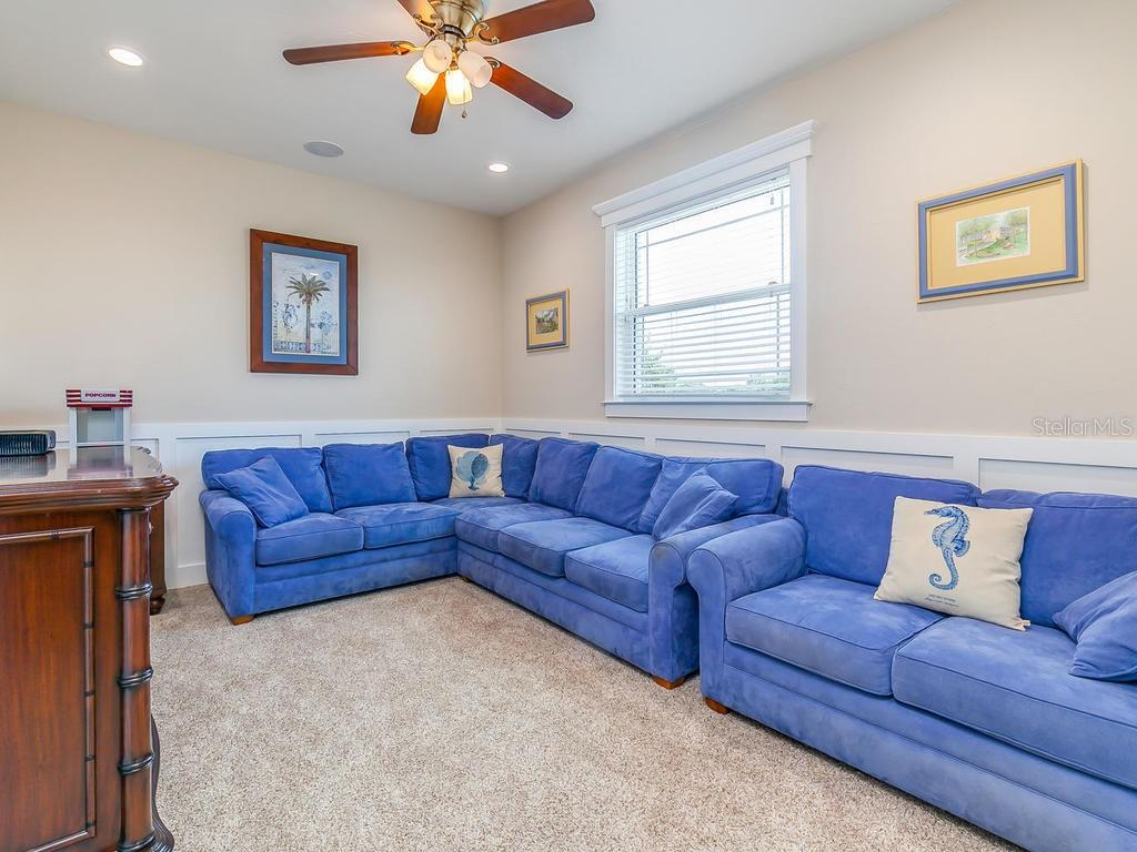 Upstairs media room, could easily be another bedroom, office, billiard room.  Many possibilities. It is adjacent to the family room and patio - Single Family Home for sale at 7643 Cove Ter, Sarasota, FL 34231 - MLS Number is A4403215