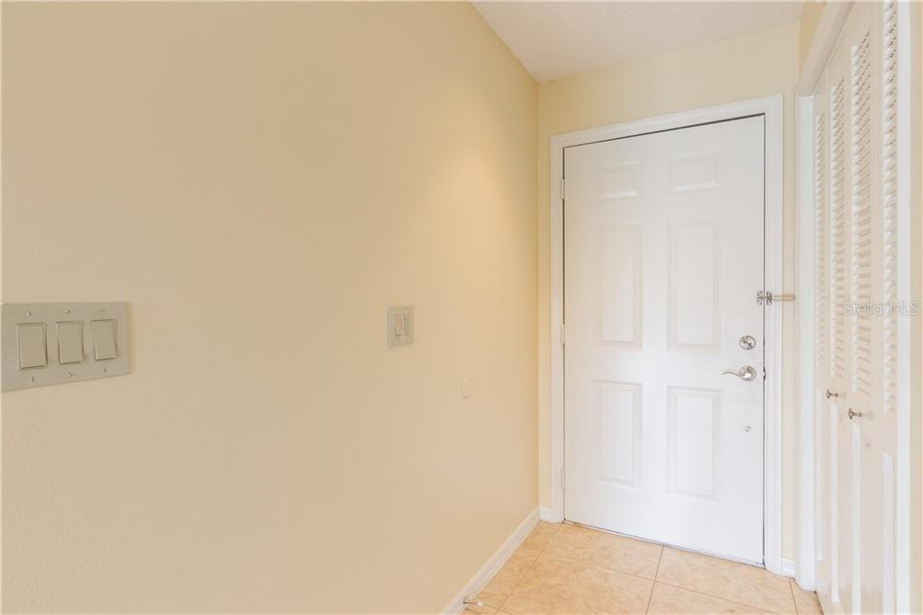 Front Door and Hall Closet - Villa for sale at 3606 Gleneagle Dr #9a, Sarasota, FL 34238 - MLS Number is A4403597