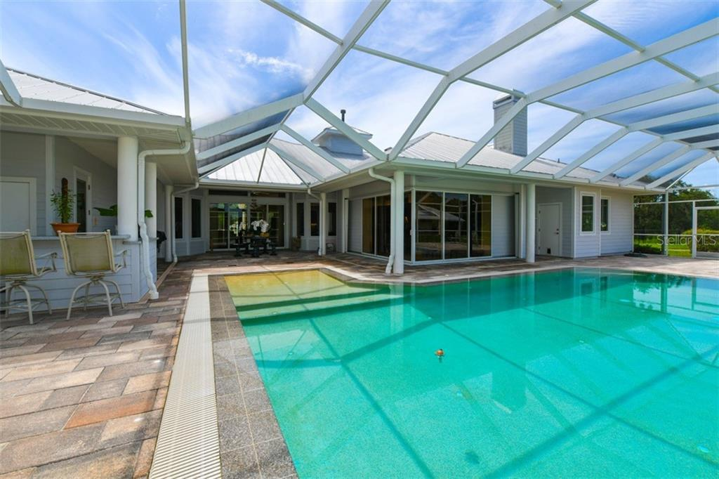 Single Family Home for sale at 7931 Lorraine Rd, Sarasota, FL 34241 - MLS Number is A4410072