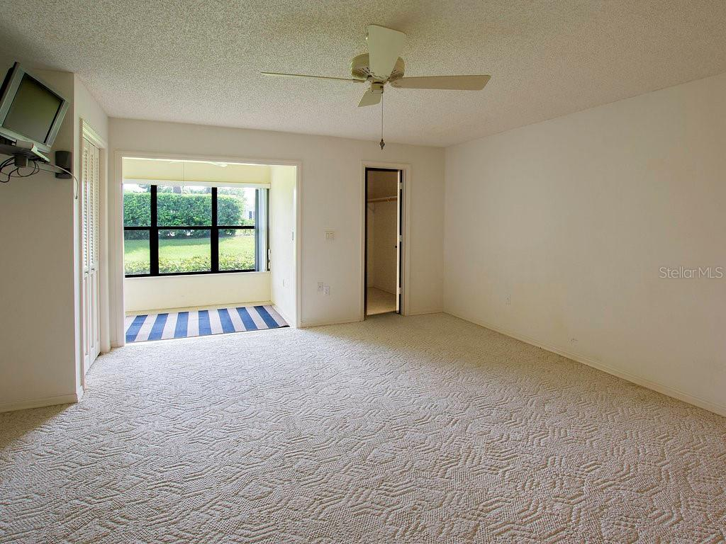 Large master bedroom with (3) closets and enclosed lanai for your enjoyment. Electric shutter on the window for peace of mind - Villa for sale at 7467 Carnoustie Dr #5d, Sarasota, FL 34238 - MLS Number is A4412518