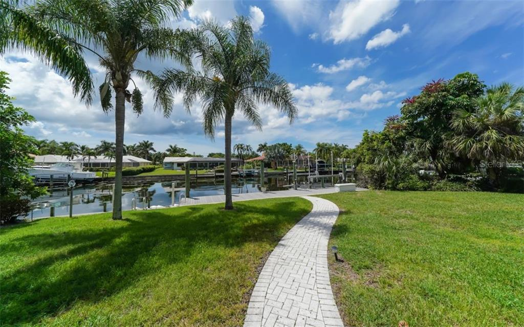 Meander out to the dock! - Single Family Home for sale at 390 Bob White Dr, Sarasota, FL 34236 - MLS Number is A4413388