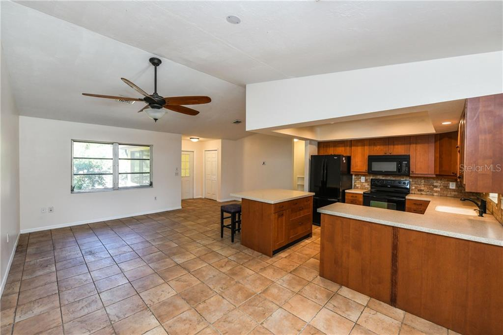 Open kitchen with great island. - Single Family Home for sale at 2045 Frederick Dr, Venice, FL 34292 - MLS Number is A4416740