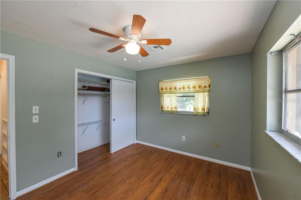 Second bedroom with large closet. - Single Family Home for sale at 2045 Frederick Dr, Venice, FL 34292 - MLS Number is A4416740