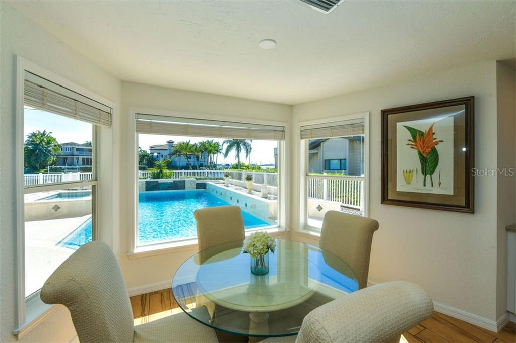 Kitchen dining area. Wow, what a view. - Single Family Home for sale at 7689 Cove Ter, Sarasota, FL 34231 - MLS Number is A4417242