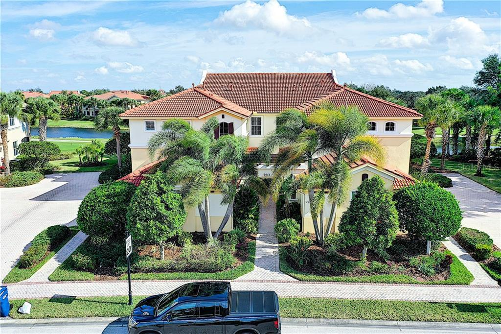 Elevated View with golf and pond out back. - Condo for sale at 9453 Discovery Ter #201c, Bradenton, FL 34212 - MLS Number is A4423314