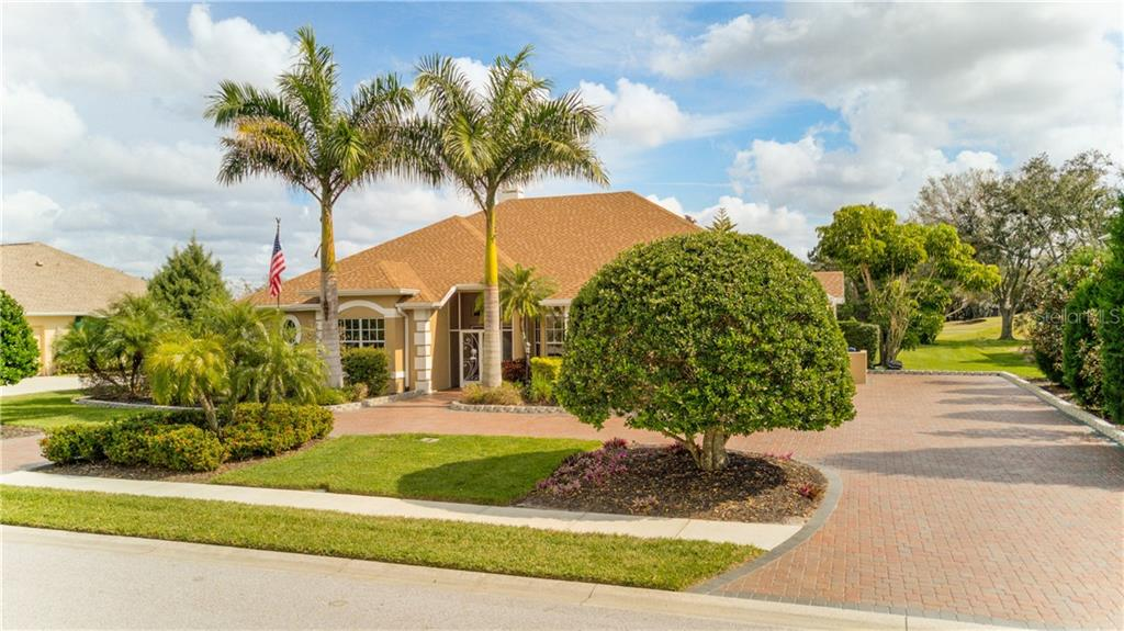 Beautiful landscaping all around the brick driveway - so private! - Single Family Home for sale at 6321 W Glen Abbey Ln E, Bradenton, FL 34202 - MLS Number is A4429610