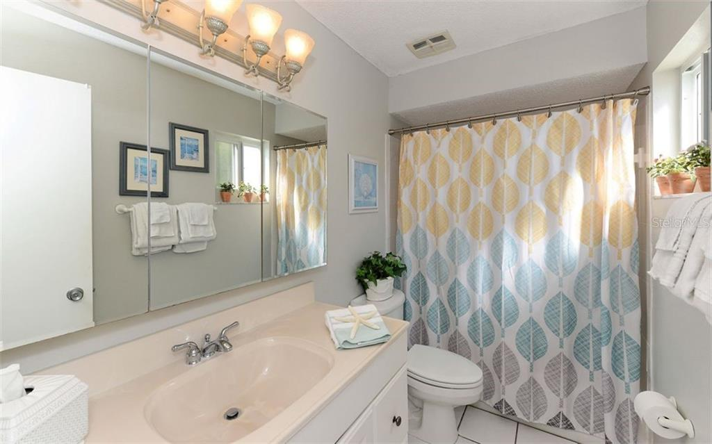 Master Bathroom. - Condo for sale at 797 Beach Rd #215, Sarasota, FL 34242 - MLS Number is A4430524