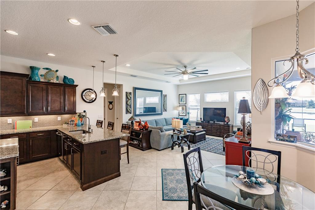 Eat in space right by the kitchen with aquarium glass window looking outside. - Single Family Home for sale at 17006 1st Dr E, Bradenton, FL 34212 - MLS Number is A4432830