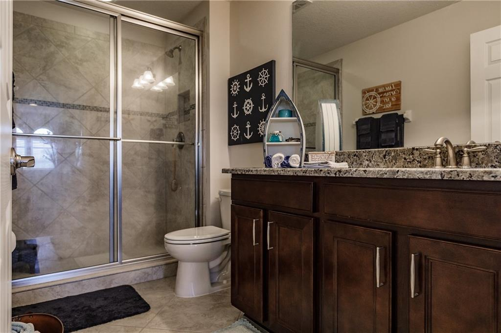 4th full bathroom located upstairs in guest quarters. - Single Family Home for sale at 17006 1st Dr E, Bradenton, FL 34212 - MLS Number is A4432830