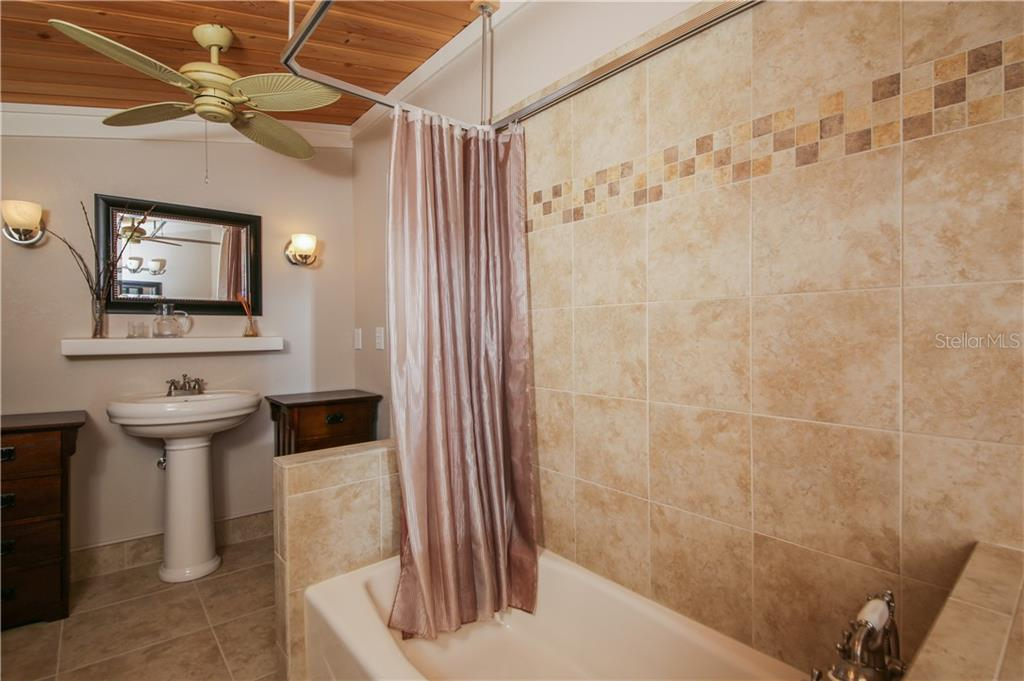 Upstairs Jack and Jill bathroom to both bedrooms - Single Family Home for sale at 7611 Alhambra Dr, Bradenton, FL 34209 - MLS Number is A4434753