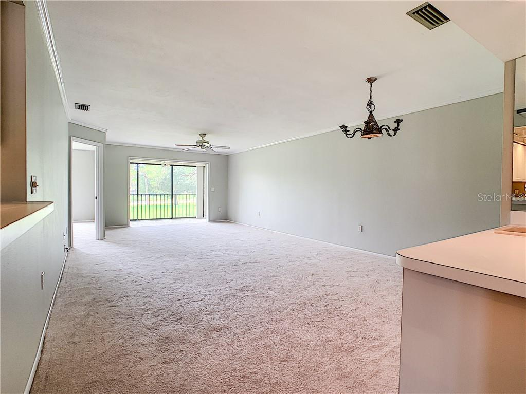 Dining Room & Living Room Combo - Condo for sale at 5777 Avista Dr, Sarasota, FL 34243 - MLS Number is A4436464