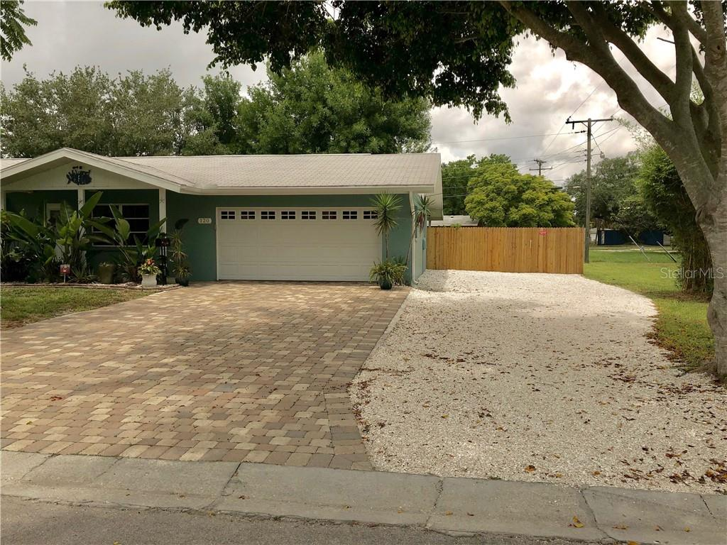 Shell parking pad and large gate opens to backyard. - Single Family Home for sale at 120 23rd Street Ct Ne, Bradenton, FL 34208 - MLS Number is A4438232