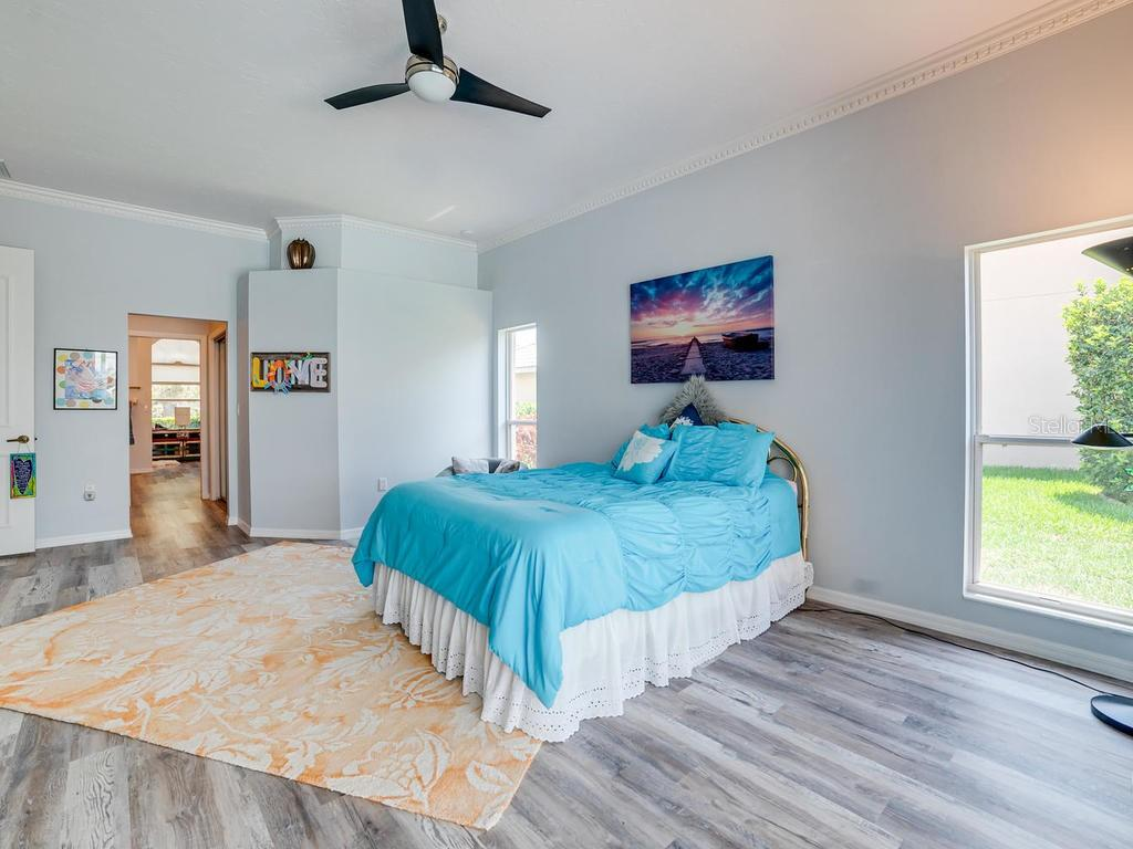 Master Bedroom, with two beautiful windows, peeking into bath area. - Single Family Home for sale at 4117 Via Mirada, Sarasota, FL 34238 - MLS Number is A4438764