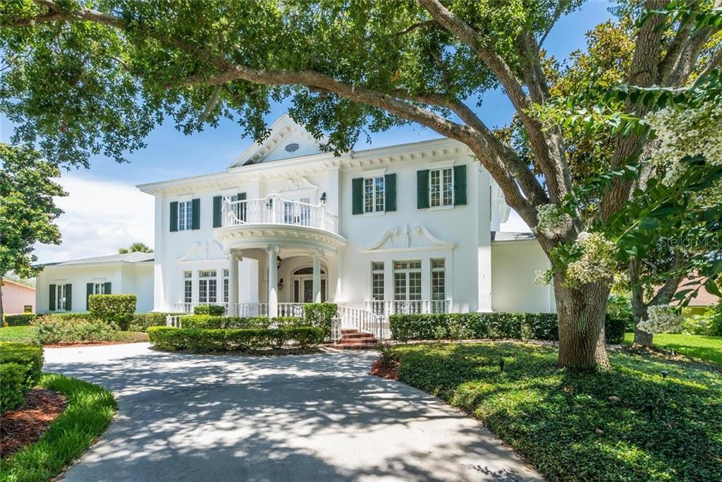The estate is bestowed with a stunning circular drive to the grand entryway with a large open balcony from the second floor. - Single Family Home for sale at 3702 Beneva Oaks Blvd, Sarasota, FL 34238 - MLS Number is A4438878
