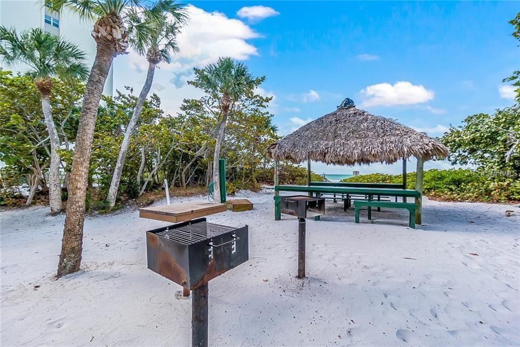 Barbecue & Tiki huts on the beach of Whispering Sands - Condo for sale at 20 Whispering Sands Dr #102 & 103, Sarasota, FL 34242 - MLS Number is A4441587