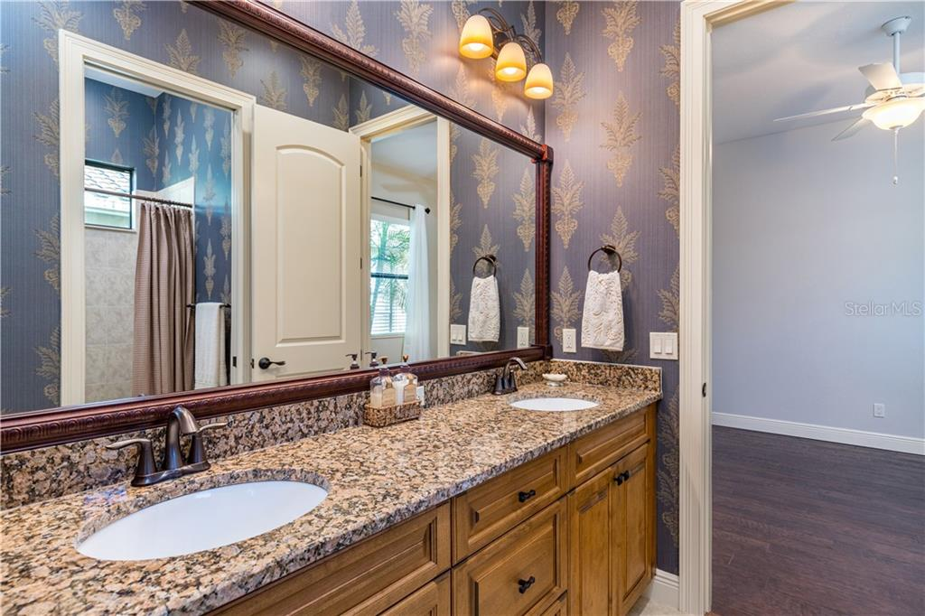 Separate shower and large relaxing tub. - Single Family Home for sale at 14710 Leopard Creek Pl, Lakewood Ranch, FL 34202 - MLS Number is A4442202