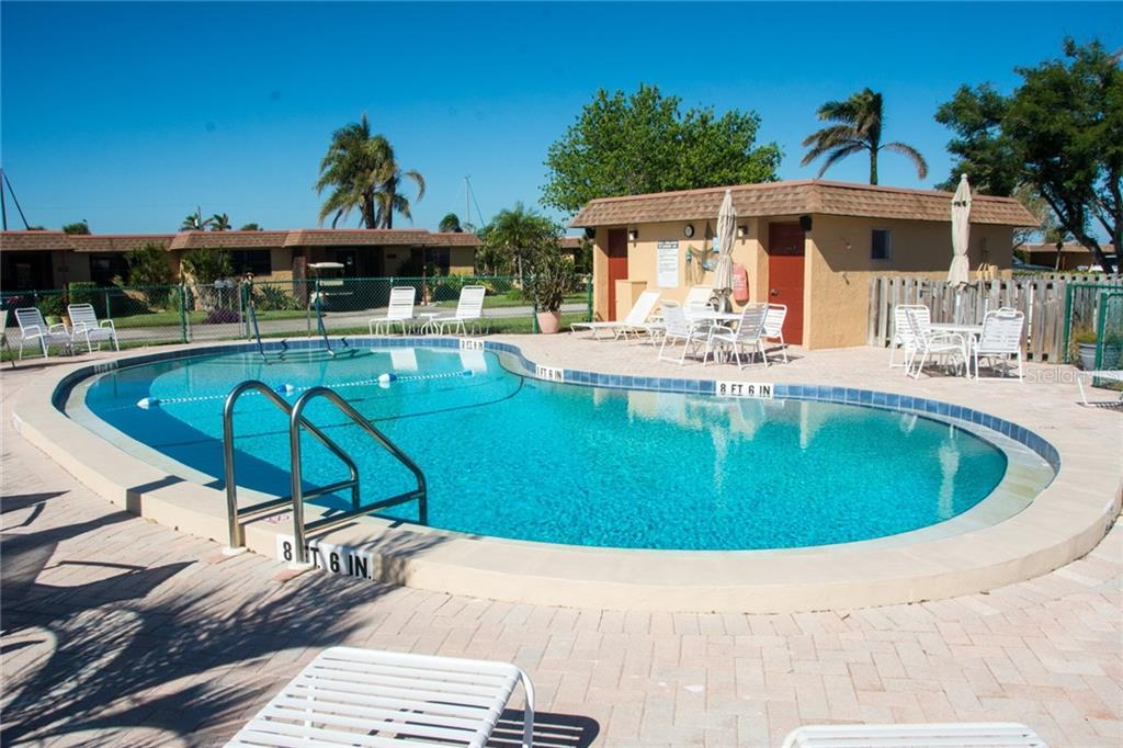 Another heated pool only steps from your condo home. - Condo for sale at 4001 Catalina Dr, Bradenton, FL 34210 - MLS Number is A4443126