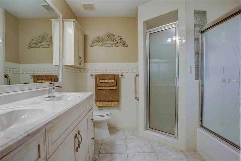 Spacious Master Bathroom with Dual sinks and updated Hardware. Shower is large and roomy, as well. Beautiful cabinetry and wall treatments make you feel as if you are in a spa like atmosphere. - Single Family Home for sale at 5109 76th St E, Bradenton, FL 34203 - MLS Number is A4443335