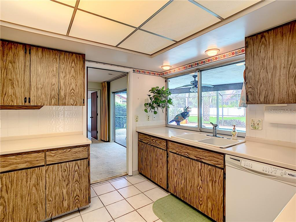 Light, bright kitchen with huge pass-through window to lanai. - Single Family Home for sale at 7006 18th Ave W, Bradenton, FL 34209 - MLS Number is A4450658