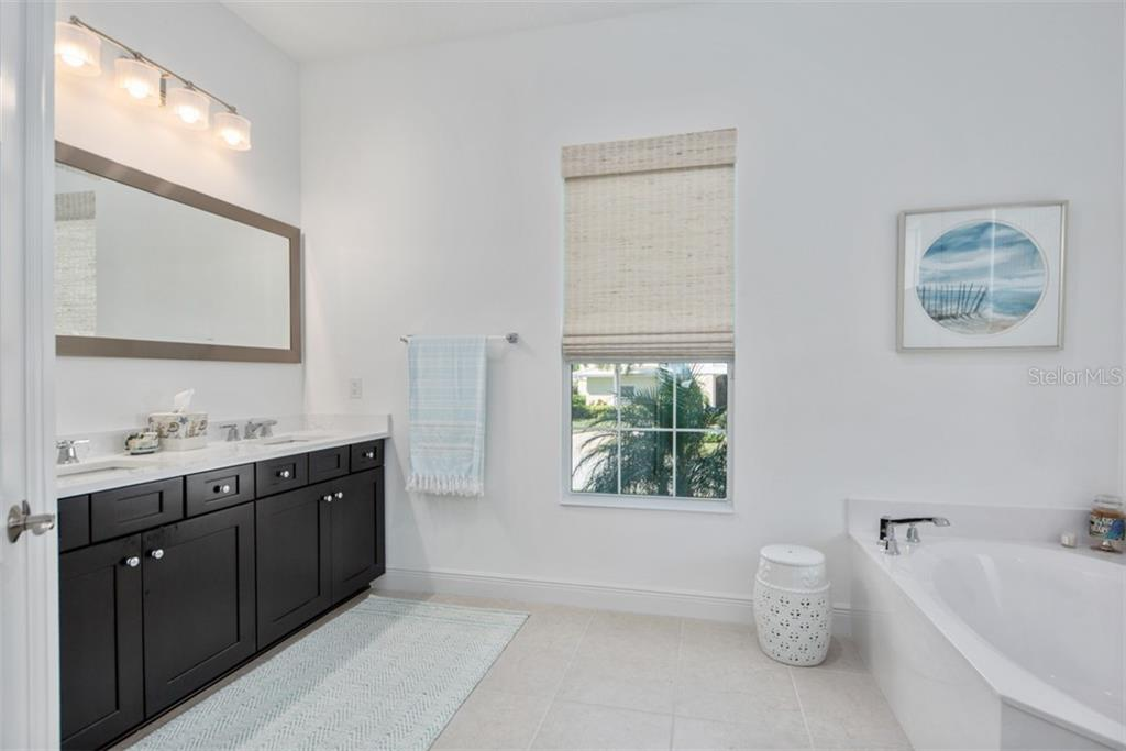 Master Bath - Single Family Home for sale at 560 Wedge Ln, Longboat Key, FL 34228 - MLS Number is A4452288