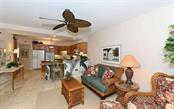 Family room/Kitchen - Condo for sale at 1260 Dolphin Bay Way #401, Sarasota, FL 34242 - MLS Number is A4173008