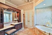 The Master Bath.  Fit for Princess.  A walk-in shower for a Prince.  Beyond those doors, the master suite expands into a sitting room and an extremely well appointed office. - Single Family Home for sale at 8365 Catamaran Cir, Lakewood Ranch, FL 34202 - MLS Number is A4187448