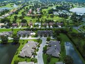 Aerial view of community surrounded by 3 large ponds - Villa for sale at 7467 Carnoustie Dr #5d, Sarasota, FL 34238 - MLS Number is A4412518