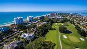 Aerial for proximity to beach. Home is located on the golf course at the center of photograph. - Single Family Home for sale at 1001 Longboat Club Rd, Longboat Key, FL 34228 - MLS Number is A4414365