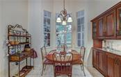 Beautiful bay window breakfast nook with lighted upper window cabinets - Single Family Home for sale at 6321 W Glen Abbey Ln E, Bradenton, FL 34202 - MLS Number is A4429610
