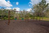 The swings are set up for toddlers AND adults! - Vacant Land for sale at 22510 Morning Glory Cir, Bradenton, FL 34202 - MLS Number is A4430942