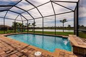 Sparkling heated pool overlooks the lake. - Single Family Home for sale at 17006 1st Dr E, Bradenton, FL 34212 - MLS Number is A4432830