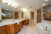 This luxurious master ensuite includes 2 private W/Cs (one with a bidet), a large walk-in shower with 7 shower heads and Pearl Jacuzzi! - Condo for sale at 128 Golden Gate Pt #902a, Sarasota, FL 34236 - MLS Number is A4433296