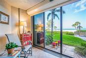 Lanai leading to the pool and beach - Condo for sale at 20 Whispering Sands Dr #102 & 103, Sarasota, FL 34242 - MLS Number is A4441587