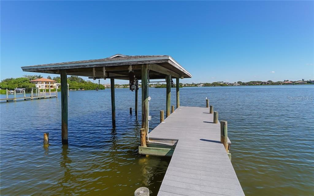 Private boat dock with cover, rare for Casey Key. - Single Family Home for sale at 3509 Casey Key Rd, Nokomis, FL 34275 - MLS Number is N5915098